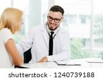 male doctor is talking with...   Shutterstock . vector #1240739188