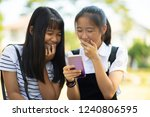 two asian teenager laughing... | Shutterstock . vector #1240806595