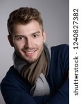 handsome young man in scarf and ... | Shutterstock . vector #1240827382