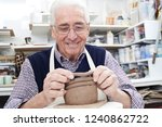 senior man making coil pot in... | Shutterstock . vector #1240862722