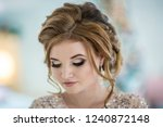 beautiful young woman at... | Shutterstock . vector #1240872148