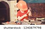 little repairman in workshop.... | Shutterstock . vector #1240879798