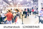 blurred motion long line of... | Shutterstock . vector #1240885465