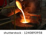 molten iron pour from ladle... | Shutterstock . vector #1240893958