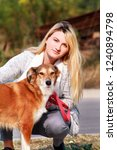 Stock photo pretty girl with his shetland sheepdog dog at nature park outdoor is standing and posing in front 1240894798