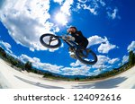 Bmx Rider Jumps While Doing...