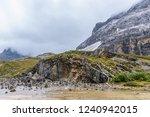 mani stones in the river under... | Shutterstock . vector #1240942015