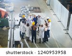 group of happy  factory workers ... | Shutterstock . vector #1240953958
