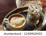 cappuccino coffee in a cup and... | Shutterstock . vector #1240963432