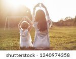 young mother and her daughter... | Shutterstock . vector #1240974358