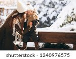 mother and son in winter... | Shutterstock . vector #1240976575