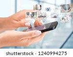 hands holding smartphone  on...   Shutterstock . vector #1240994275