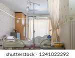 hospital room with beds and... | Shutterstock . vector #1241022292