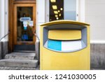 traditional yellow postbox in... | Shutterstock . vector #1241030005