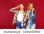 two beautiful smiling hipster... | Shutterstock . vector #1241033902
