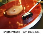 Red Vinyl Record Closeup On A...