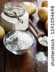 potato starch in a glass bowl...   Shutterstock . vector #1241054698