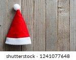 santa hat on old wood table... | Shutterstock . vector #1241077648