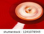 vinyl record rotate. a ray of... | Shutterstock . vector #1241078545