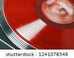vinyl record rotate. a ray of... | Shutterstock . vector #1241078548