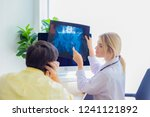 the doctor is diagnosing the... | Shutterstock . vector #1241121892