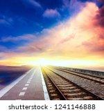 railroad to horizon under... | Shutterstock . vector #1241146888
