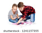 brother and sister having fun... | Shutterstock . vector #1241157355