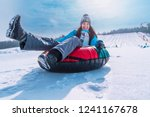 young pretty woman smiling snow ... | Shutterstock . vector #1241167678