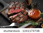 sliced grilled medium rare beef ... | Shutterstock . vector #1241173738