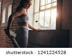 muscular young fitness model... | Shutterstock . vector #1241224528