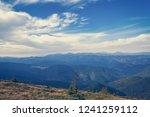 blue cloudy sky in carpathians... | Shutterstock . vector #1241259112