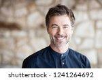 closeup of a mature man smiling ...   Shutterstock . vector #1241264692