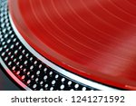 vinyl record closeup. a ray of... | Shutterstock . vector #1241271592