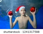 charming little boy posing with ...   Shutterstock . vector #1241317588