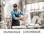 handsome sculptor brushing... | Shutterstock . vector #1241400628