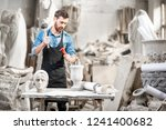 portrait of a handsome sculptor ... | Shutterstock . vector #1241400682