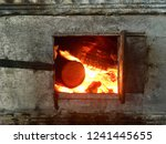 burning fire in rustic stove.... | Shutterstock . vector #1241445655