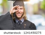 young handsome graduated man... | Shutterstock . vector #1241450275
