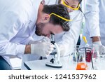 scientists working in... | Shutterstock . vector #1241537962