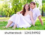 couple in the park sitting on... | Shutterstock . vector #124154902