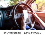women use cell phones in cars. | Shutterstock . vector #1241599312