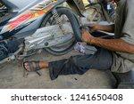 motorcycle repair workers are... | Shutterstock . vector #1241650408
