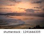 seeing sunset along the beach... | Shutterstock . vector #1241666335
