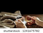 hands holding cookie and coffee ... | Shutterstock . vector #1241675782