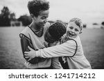 junior football team hugging... | Shutterstock . vector #1241714212
