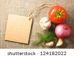 tomato onion and garlic vegetables and price tag on sacking background texture - stock photo