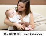 mother hugs her son.a young... | Shutterstock . vector #1241862022