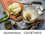 raw cauliflower ground in food... | Shutterstock . vector #1241874655