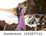 beautiful young couple hugs and ... | Shutterstock . vector #1241877112