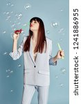 beautiful woman celebrating a... | Shutterstock . vector #1241886955